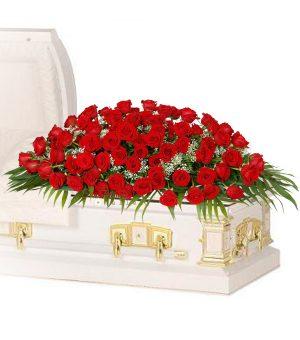 100 Red Rose Casket Spray Delux